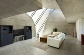 Beautiful modern house in cement, interior, living room — Zdjęcie stockowe