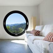 Interior room with a circular window — Stock Photo
