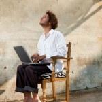 Boy working on laptop — Stock Photo #24643171