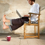 Boy working on laptop — Stock Photo #24643385