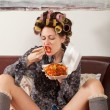 Sexy girl eating spaghetti on the couch - Stock Photo