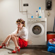 Housewife bored in the laundry — Stock Photo