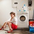 Housewife bored in the laundry — Stock Photo #25700485