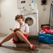Housewife bored in laundry — Stock Photo #25702619