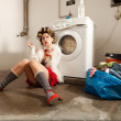 Housewife bored in the laundry - Stock Photo