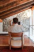 Man watch a tv on a armchair — Stock Photo