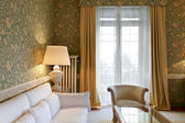 Interior luxury apartment, comfortable classic living room, white divan — Stock Photo