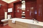 Interior luxury apartment, red bathroom — Stock Photo