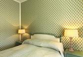 Interiören lyxlägenhet, bekväma sovrum — Stockfoto