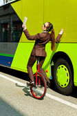 Business woman go to work in monocycle — Stock Photo