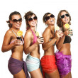 Four girls fun with a drink, portrait in studio, isolated on white background — Stock Photo #29996601