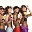 Four girls fun with a drink, portrait in studio, isolated on white background — Stock Photo #29997699
