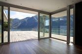 Beautiful penthouse with big window and mountain view — Stock Photo