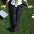 Businessman relaxing on grass — Stock Photo #30040017