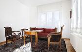Interior of a modern apartment, antique style furniture — Stok fotoğraf