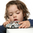 Child Girl playing with little car — Stock Photo