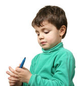 Portrait of boy with pen — Stock Photo