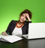 Businesswoman sitting on workplace — Stock Photo