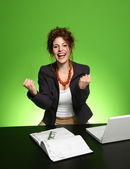 Happy businesswoman on work place — Stock Photo