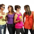 Four girls fun with a drink — Stock Photo
