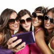 Happy young girls while taking pictures — Stock Photo #30811123