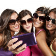 Happy young girls while taking pictures — Stock Photo