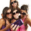 Happy young girls while taking pictures  — Stockfoto