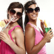 Two girls fun with a drink — Stock Photo
