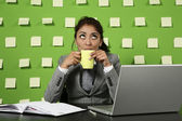 Businesswoman with cup of tea on work — Stock Photo