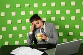 Businesswoman sitting on workplace — Stock Photo