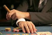 Man sitting in casino — Stock Photo