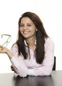 Businesswoman sitting on desk — Stock Photo