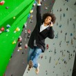 Stock Photo: Young business womhanging at wall, beautiful girl