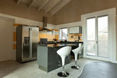Kitchen island with two stools — 图库照片