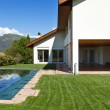 House and pool, exterior, summer day — Stock Photo #35667463