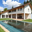 Country house with swimming pool — Stock Photo