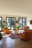 Living room with orange armchairs — Stock Photo