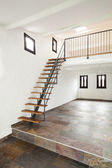Large room with staircase — Stock Photo