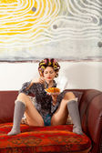 Sexy girl eating spaghetti on the couch — Stock Photo