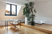 Beautiful loft, dining table — Stock Photo