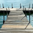 Jetty on lugano lake — Stock Photo