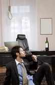Businessman with wine and gallows — Photo