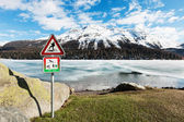 Frozen alpine lake — Stock Photo