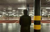 Man on underground parking — Stockfoto