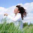 Royalty-Free Stock Photo: Girl running across field