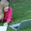 Royalty-Free Stock Photo: Young student outside in the park with computer and notebook