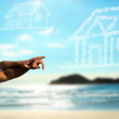 Happy couple on the beach dreaming of a house. — Stock Photo
