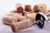 Bunch of corks and corkscrew — Stock Photo