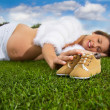 Pregnant woman lying on the grass — Stock Photo #30580599