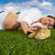 Pregnant woman lying on the grass — Stock Photo